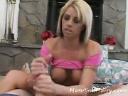 Buxom platinum blonde on knees giving great handjob