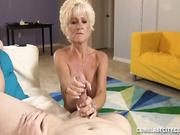 Mature Nikki stroking big cock