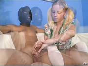 Pretty Alyssa milking a masked boy