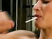 Girl sucking a lollypop and giving a handjob