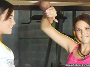 Brandi and her friend licking balls in the glory hole