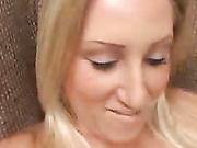 Blonde slut rubs a stiff penis