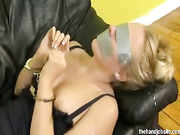 Taped up whore tugs on long cock