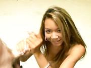 Asian Keanni Lei rubbing handling a huge wand