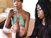 Two ebony sluts jerk off big throbbing knob