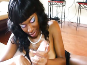 Ebony slut tit fucks a big throbbing chopper