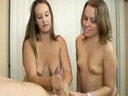 Amber and Lexi take turn in stroking a cock