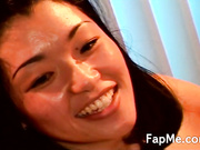 Hot Asian chick strokes two large dongs